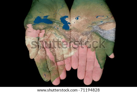 Map Of The Middle East Painted On Hands Showing Concept Of The Middle East In Our Hands
