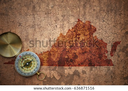 map of virginia state on a old vintage crack paper background with compass