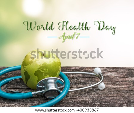 Map on healthy fruit food green fresh organic natural nutrient apple w/ doctor\'s stethoscope heart shape grunge old aged wood background: World health day WHD April 7 symbolic conceptual design idea