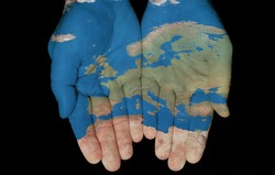 Map painted on hands showing concept of having Europe in our hands