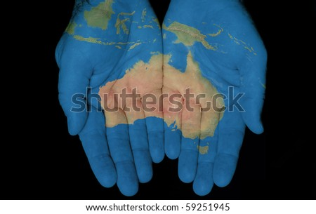 Map painted on hands showing concept of having the Country Of Australia in our hands