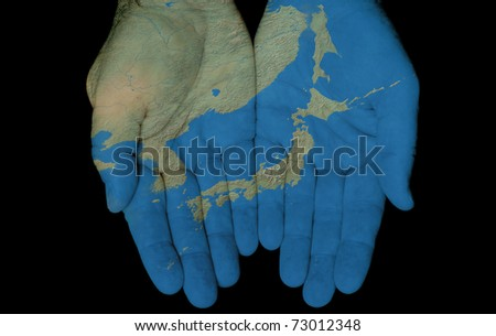 Map Painted On Hands Showing Concept Of Having The Country Of Japan In Our Hands