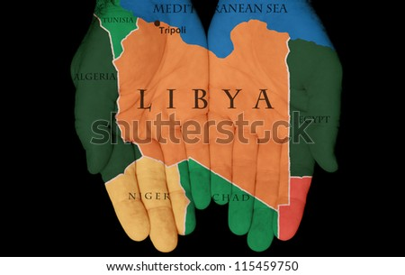 Map Painted On Hands Showing The Concept Of Having Libya In Our Hands