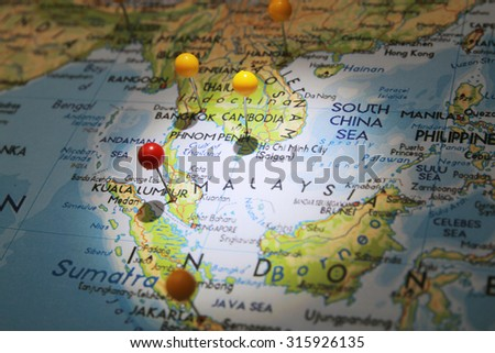 Map pins on map with focused light and red pin on Kuala Lumpur city #315926135