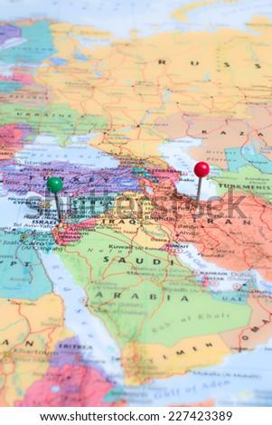 Map pins placed at Israel and Tehran, Iran. A green map pin placed at Israel and a red map pin placed at Tehran.