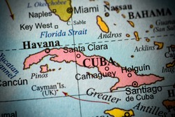 Map view of Cuba on a geographical globe. (vignette)