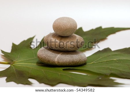 Maple leaf and round stones