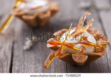 Maple mousse in almond basket with caramel decoration