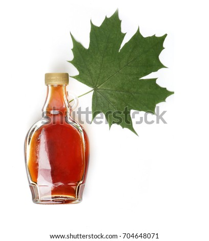 maple syrup and maple leaf on white background #704648071