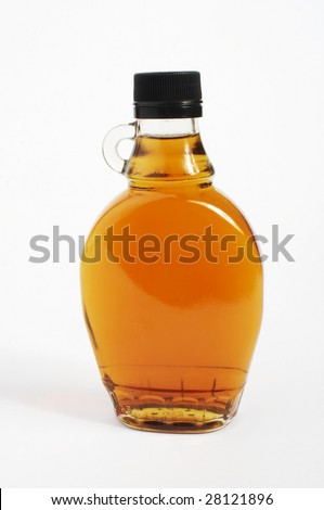 Maple syrup in a glass bottle on a white background