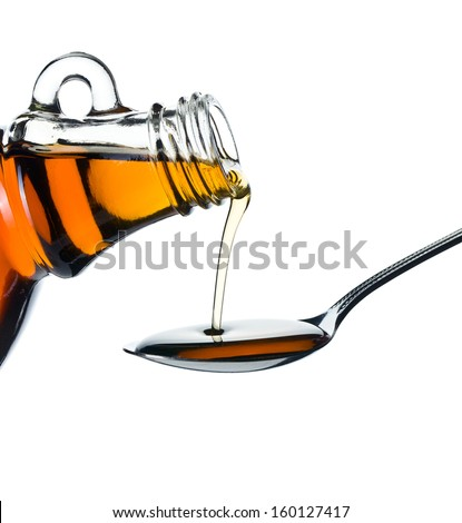 maple syrup pouring on spoon on white background #160127417