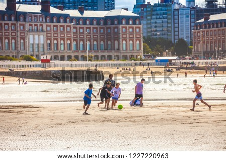 Mar Del Plata, Argentina - 26 Octubre, 2018: Children playing football on the shores of the Atlantic Ocean