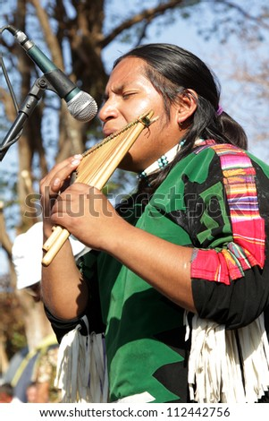 "MARACAI, SAO PAULO/BRAZIL - AUGUST 26: An unidentified peruvian indian musician at the annual religious pilgrimage of ""Menino da Tabua"" festival on August 26, 2012 in Maracai, Sao Paulo, Brazil."