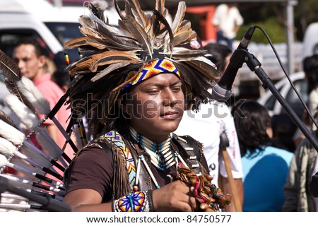 "MARACAI, SAO PAULO/BRAZIL - AUGUST 28: An unidentified peruvian indian singer at the annual religious pilgrimage of ""Menino da Tabua"" festival that attracts 15.000 visitors by year on August 28, 2011 in Maracai, Sao Paulo, Brazil."
