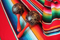 maracas poncho Mexican maraca background serape traditional cinco de mayo Mexico rug blanket fiesta shakers with stripes copy space flat lay minimal simple stock, photo, photograph, image, picture