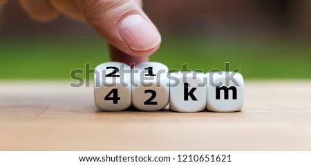Marathon and half marathon distances labled on dice #1210651621