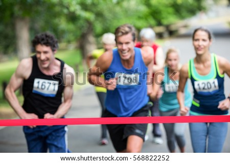 Marathon athletes close to the finish line in park