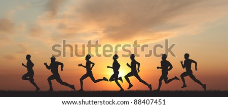 Marathon, black silhouettes of runners on the sunset - stock photo