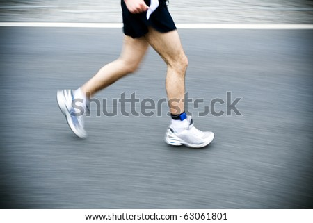 Marathon runner motion blur on city street
