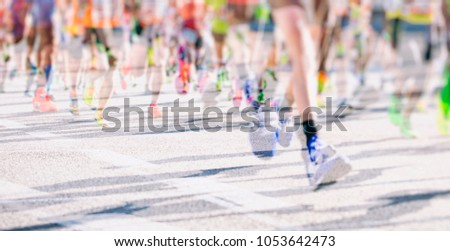 marathon runners in the city  #1053642473