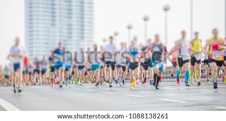 marathon runners in the city  #1088138261
