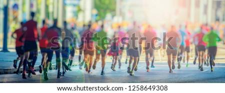 marathon runners in the city  #1258649308