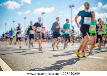 marathon runners in the city  #1273450249