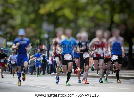 marathon runners in the city  #559491115
