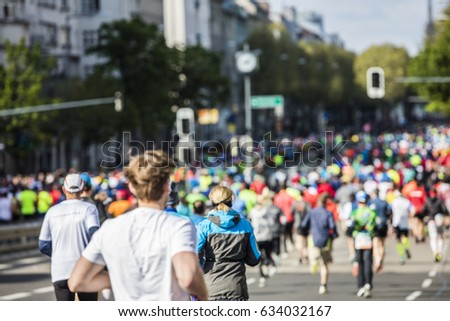 marathon runners in the city  #634032167