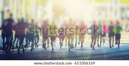 marathon runners in the city  #651006169