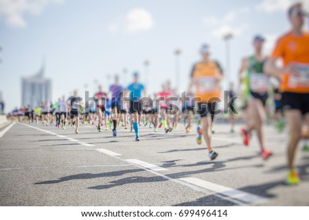 marathon runners in the city  #699496414