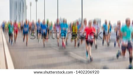 marathon runners in the city . city runners  #1402206920