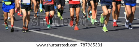 marathon runners legs running on city road #787965331