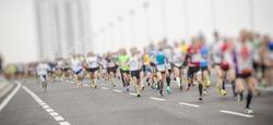 marathon runners ,motion blur running people in the city