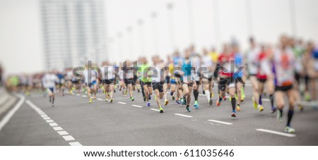marathon runners ,motion blur running people in the city  #611035646