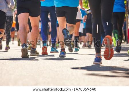Marathon runners on the street. Healthy lifestyle. Athlete endurance