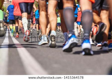 Marathon runners on the street. Healthy lifestyle. Athletes endurance