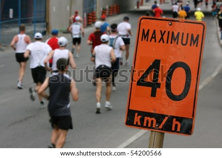 Marathon runners passing through a construction zone. Ottawa, Ontario. Canada.