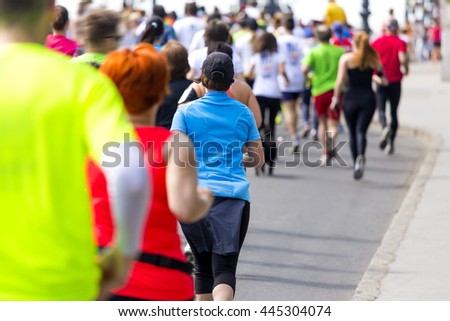 marathon runners running in colorful sportswear on the street #445304074