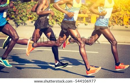 marathon runners running on city road #544106977