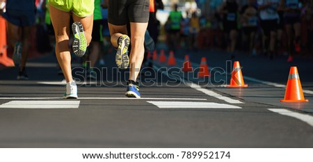 Marathon runners running on city road,detail on legs.Copy space #789952174