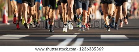 Marathon runners running on city road, large group of runners Stock fotó ©