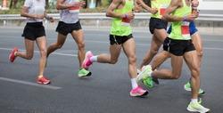 Marathon runners running on the race on city road