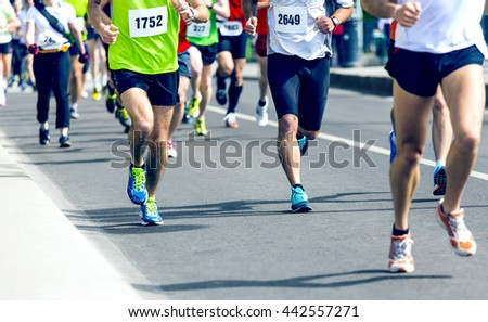 marathon runners running on the street #442557271