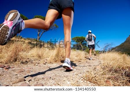 marathon running athletes couple training on trail fitness sport active lifestyle