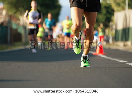 Marathon running in the light of evening #1064515046