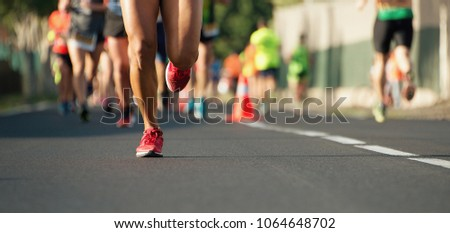 Marathon running in the light of evening #1064648702
