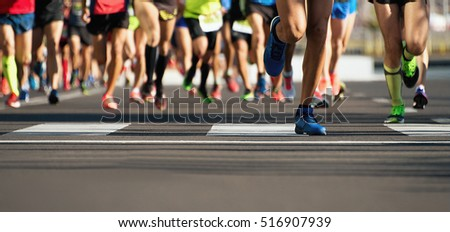 Photo of  Marathon running in the light of evening