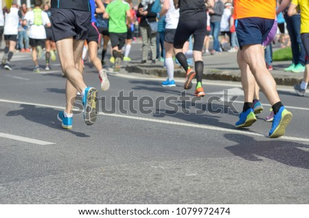 Marathon running race, many runners feet on road racing, sport competition, fitness and healthy lifestyle concept #1079972474