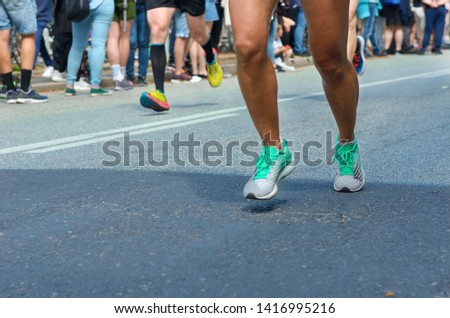 Marathon running race, many runners feet on road racing, sport competition, fitness and healthy lifestyle concept #1416995216